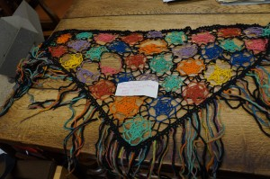 Triangular shawl with different coloured webs sewn together