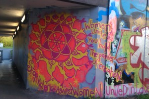Colourful piece of graffiti that says 'Stop Violence Against Women'