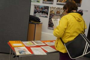 An attendee reads the archive material displayed at the event