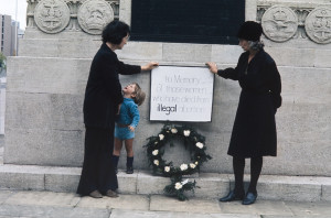 Two women lay a wreath at the war memorial in the centre of Bristol in memory of women who had died from illegal abortions