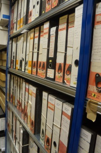 Two shelves of box files