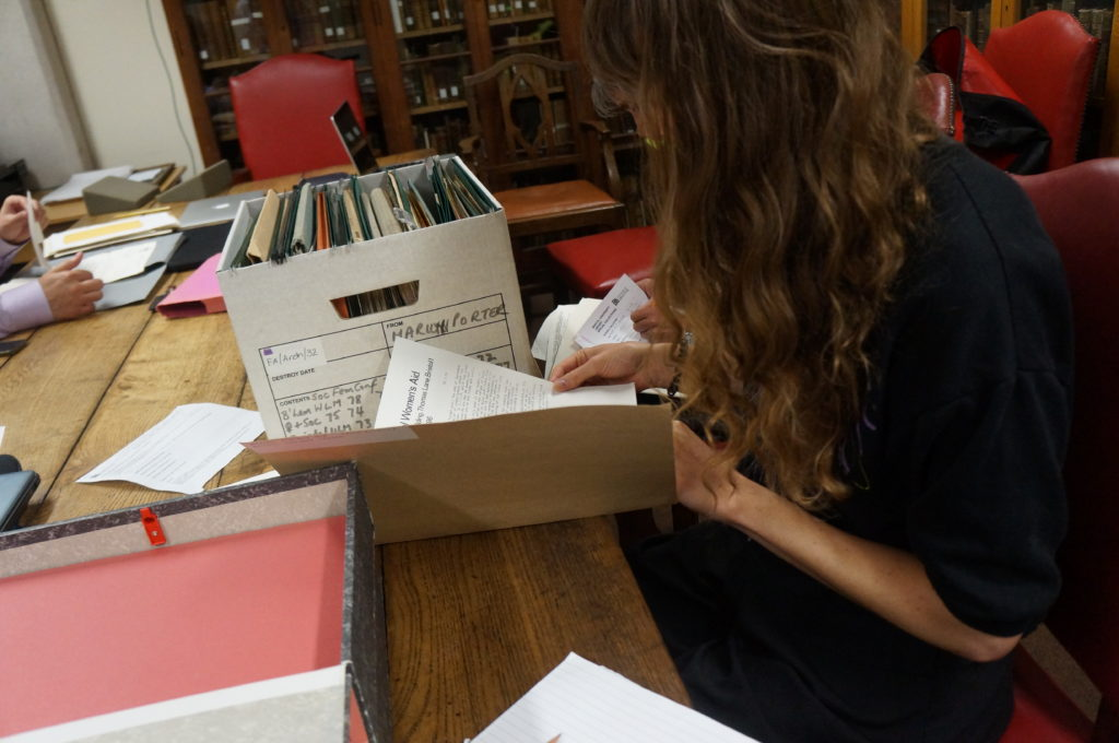 A researcher reads in the Feminist Archive South