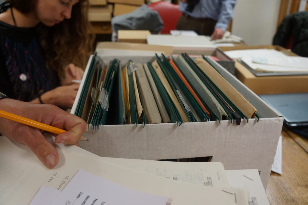 A folder of archive material full of papers